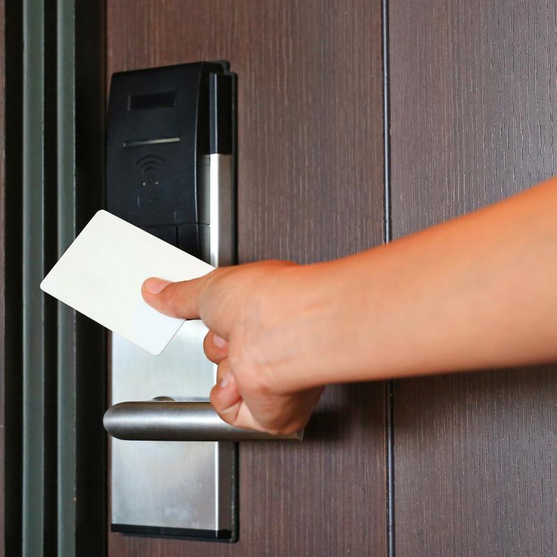 Scanning card to unlock the door.